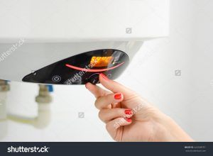 stock-photo-adjusting-a-hot-water-boiler-or-heater-424508791